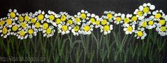daffodils - reverse the colours.  White / orange centers; yellow petals