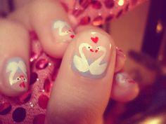 Really cute swan nails.