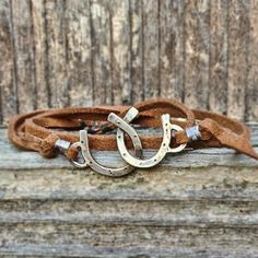 Items similar to Double Horseshoe leather wrap bracelet - cowgirl jewelry on Etsy Equestrian Jewelry, Horse Jewelry, Cowgirl Jewelry, Western Jewelry, Equestrian Shop, Equestrian Outfits, Bracelets Wrap En Cuir, Jewelry Bracelets, Geek Jewelry