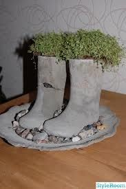 old rubber boots - fill and cut off (leave PVC or ? to create planting area)