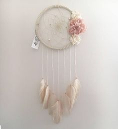 This beautiful large 9 dream catcher would be the perfect addition to any living space! Its stunning, over-sized florals are surely to get noticed. If you love florals, pinks, creams & sparkles then this is the piece for you! It has been hand crafted with love and good intentions.