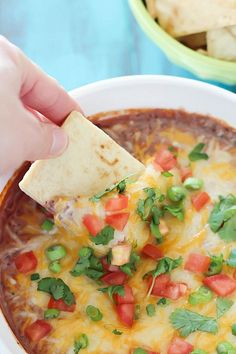 Healthy and addicting black bean dip - the perfect snack full of protein to keep you satisfied! Best served with pita chips, tortilla chips or veggies.