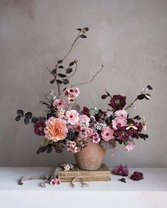 A bright but moody mix of pinks, plums, and peach flowers in a terracotta vase. Ikebana Flower Arrangement, Vase Arrangements, Floral Centerpieces, Flower Vases, Arte Floral, Flower Studio, Flower Wallpaper, Flower Designs, Planting Flowers