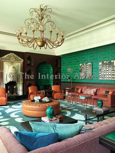 Vintage pieces of furniture such as the 1930s armchairs and antique fireplace from Anatolia in Turkey are given a new contemporary, luxury setting in the living room; papered with Osborne & Little wall fabric, a hand-made carpet and bespoke Ottoman designed by Hall