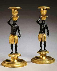 Pair of Louis XV Gilt and Patinated-Bronze Blackamoor Candlesticks Late 18th century Each figural-form standard with a feather skirt and crown, cresting in an urn-form socket, raised on a circular molded base.