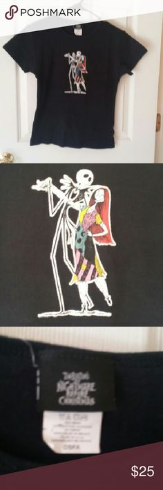 Nightmare Before Christmas Jack & Sally ter NWOT Nightmare Before Christmas Jack & Sally rare design tee. it is a, junior One Size Fits All,  but really a small. Jack and Sally are dancing on a plain black background.  Cool. Smoke-free home. Giant Merchandising  Tops Tees - Short Sleeve