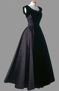 "Evening Dress, Norman Hartnell: ca. 1940's, silk, velvet. ""This dress shows the influence of the 'New Look' introduced by Christian Dior in 1947, which combined a narrow waist with full skirts."""