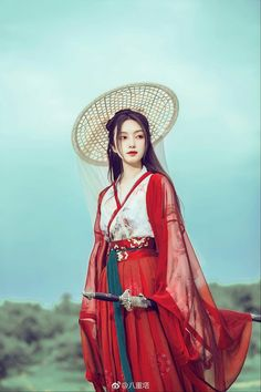 Traditional Chinese Hanfu - Type: Waist-high Ruqun/襦裙 and Daxiushan/大袖衫 (large-sleeve robe). The hat is a Weimao/帷帽.
