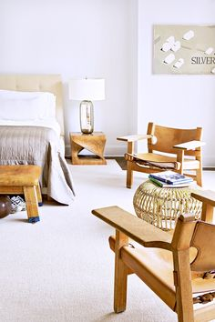 Tour a Gorgeously Layered, Artistic Hamptons Home//neutral bedroom, albini stool, mercury glass