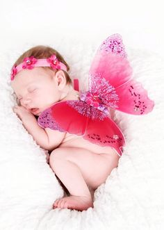 """Jeweled Dark Pink Butterfly Fairy Newborn Wings for Photo Prop      Our deep pink fairy wings are stunning for portraits! These tiny wings measure a petite 8"""", and make a unique photo prop. Beautiful detailed wings feature pink glitter and hand set sequins. Middle of wings are blooming with a deep pink sequin petal."""