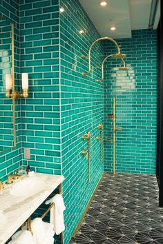 Take a First Look Inside the New Williamsburg Hotel: We had the chance to be one of the first guests to get a glimpse of the new property, and we can safely say it is poised.  ---- Teal bathrooms bathrooms equipped with elegant brass fixtures. Coveteur.com