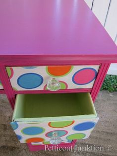 Decoupage or fabric covered drawer fronts!