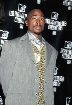 Tupac Shakur at the 1996 MTV Video Music Awards. RIP.