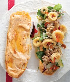 Fiery sriracha sauce and fresh herbs and cucumbers balance the richness of author Tom Colicchio's Fried Calamari Sandwich.