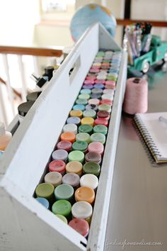 What a great way to store paints! Ikea Hack Craft Table (& Craft Paint Storage!) - Finding Home @Laura Putnam - Finding Home