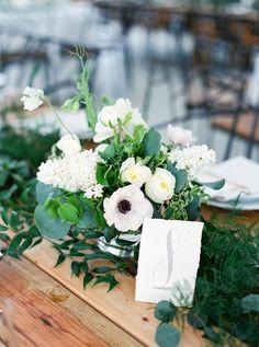 Springtime centerpiece with ranunculus and anemone: http://www.stylemepretty.com/texas-weddings/austin/2016/08/04/organic-spring-wedding-in-texas/   Photography: Jen Dillender - http://jendillenderphotography.com/