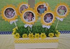 We picked a Sunshine theme because Lyla is one of the most happy, sweet  babies I have ever been around. She really is like a little ray of  sunshine and whoever spends time with her always has their day  brightened by her sweet spirit.We made centerpieces that showcased Lyla girl each month. Mindy took  pictures of Lyla in the same chair every month to chart her growth. We  took the pictures and made sunshines numbering each sunshine to go with  the month Lyla was in the picture.View This…
