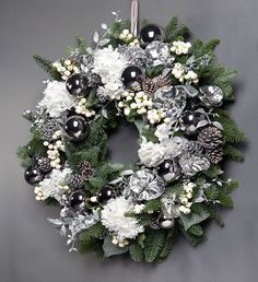 WINTER WONDERLAND WREATH       Conjuring up visions of snow covered flowers and pine cones, this wreath, which is based on a winter wonderland scene, features (fake) white hydrangea, white berries and white and silver decorations that create a chic door decoration.   http://shop.wildatheart.com/collections/christmas-wreaths-1/products/winter-wonderland-wreath