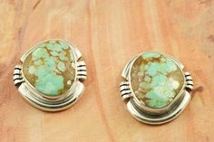 Genuine Number 8 Mine Turquoise set in Sterling Silver Post Earrings. The Number 8 mine is located in Eureka County Nevada. Since 1976 there has been no Number 8 Turquoise mined. There is however, an existing stock pile that Mr. Dowell Ward, the last owner of the Number 8 mine, had stocked away for later sorting. The Turquoise is a collector's item--because once the reserve is gone there will be no more material released onto the market. The Gold Mining Company owns the claim to the Number 8…