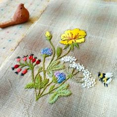 Embroidery flowers and bee