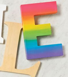 An easy way to create your own ombre, paper mache letter to celebrate spring.| Paper Mache Hand-Painted Ombre Letter DIY