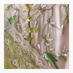 Paradise Parrots. Stunning floret lata and flying parrots hand embroidery thread work. Now in Stores . 04 August 2017