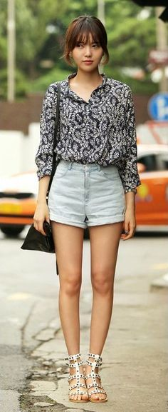 flowy shirt tucked into high-waisted shorts