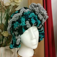 "NEW ""THE CHARLOTTE"" HANDMADE HAT Handmade crochet hat. Very warm chunky yarn. Unique style. You will not see another person in your town with this hat. This is my original design...no pattern :). Colors are gray, turquoise, blue, and black.  It is a hat that will fit snug around your forehead. handmade Accessories Hats"