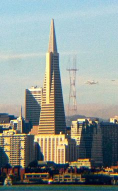 Endeavour space shuttle flying by the Transamerica building San Francisco Bay, San Francisco Skyline, Transamerica Pyramid, Environmental Justice, Building Companies, Stanford University, Famous Landmarks, Space Shuttle, Boat Building