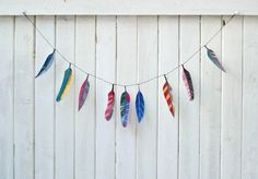 DIY feather idea ~ water colour feathers! Turn plain white feathers into artwork.