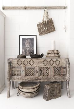 A rustic corner of our store with the old Indian Damchiya taking center stage. Framed image by Gerry Pacher. Photography and styling by @villastyling