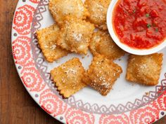 Missouri Fried Ravioli -- Crispy on the outside, filled with soft cheese and liberally dipped in marinara sauce, this is an appetizer we can get behind. #AcrosstheCountry