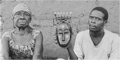 Context photo.  Baule portrait mask of Moya Yanso and stepson, Kouame Ndri.  Kami village, Baule, Ivory Coast.  Mask carved around 1913, photographed in 1971. Portrait mask (Mblo). Baule peoples (Côte d'Ivoire). Late 19th to early 20th century C.E. Wood and pigment.Portrait mask of Moya Yanso Medium: wood and pigment Artist/Culture: Owie Kimou Awka region, southeastern Nigeria, lbgo-speaking peoples Date: 1913