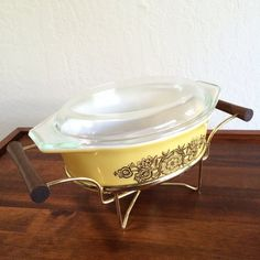 Pyrex Rare, Golden Rosette Yellow Pyrex Casserole with lid, Warming Stand, 1960s