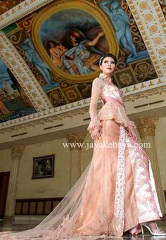 Kebaya Fashion with Orange color and a large trail with oval shave.it's make like europan dresess.but this one original kebaya from indonesia Jakarta Raya.100% cotton