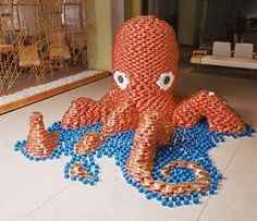 Octopus. Canstruction: Fighting Hunger With Fantastic Food Can Sculptures @Charles Tocknell II