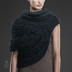 Call it a scarf. Call it a vest. Call it a shawl. Call it a cowl. Or, heck, call it a cape. It won't matter how you refer to Katniss' (Jenni...