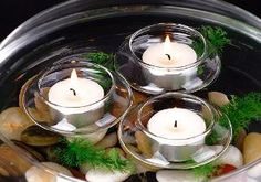 clear floating tea light holders with tea lights | wedding centerpiece DIY