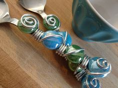 Dessert Spoons: Wire wrapped dessert and serving spoons with colored glass tear drops