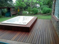 Jacuzzi and deck , by Decks and Things. Kempas decking.