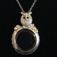 """Circle embedded glass (not magnifying). Mystical Owl Looking Glass Silver Tone Necklace. Silver Plated Owl Pendant. Silver tone chain is 16"""" with a 3"""" extender. 2.5"""" pendant height. 