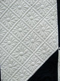 The Secret Life of Mrs. Meatloaf: Oklahoma City Winter Quilt Show - corner quilting in a Feathered Star quilt.