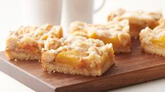 Pillsbury's – Brown Butter Peach Crumble Bars recipe. These delicious peach crumble cookie bars are even better topped with a scoop of ice cream. Just Press Play to Get Cooking! Spring Desserts, Desserts To Make, Köstliche Desserts, Delicious Desserts, Dessert Recipes, Bar Recipes, Spring Treats, Recipies, Impressive Desserts