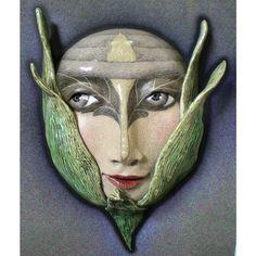 Blending In - Ceramic Wall mask.  via Etsy.