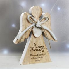 Personalised In Loving Memory Rustic Wooden Angel Decoration Our In Loving Memory Rustic Wooden Angel Decoration is an elegant way of celebrating the life of a loved one RRP $£14.99