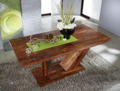 Tisch aus Palisanderholz der Serie DUKE. Das schön gemaserte dunkle Holz und die moderne Form erschaffen einen edlen Effekt. #möbel #möbelstücke #wohnzimmer #holz #echtholz #massivholz #wood #wooddesign #woodwork #homeinterior #interiordesign #homedecor #decor #einrichtung #furniture #livingroom #livingroomideas #ideas #massivmoebel24 #esstisch #diningtable #table #tisch #tischgestell #palisander #sheesham #holztisch #esszimmer #diningroom Table And Chairs, Dining Table, Solid Wood Table, Table Height, Chair Bench, Simple Elegance, Home Interior, Modern, Shapes
