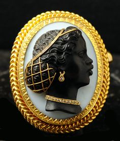 "1860 - French - ""Blackamoor"" cameo -- gold pendant with a cameo oval cut in onyx with diamond accents."