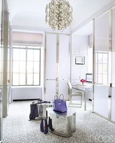 Very chic closet! A little cold and could be warmed up with cushions or a tufted ottoman but very sleek regardless.