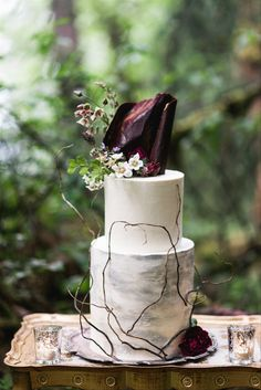 A basic white buttercream cake is transformed into an artistic creation with the help of vines, flowers and an abstract chocolate topper. - gothic + Halloween wedding inspiration Wedding Cake Prices, Floral Wedding Cakes, Cool Wedding Cakes, Floral Cake, Wedding Colors, Wedding Flowers, Dress Wedding, Modern Wedding Inspiration, Wedding Decorations