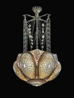 Tiffany chandelier, c. 1895 - WOW. What an amazing piece which I would love to install in a NON art-deco space. it also reminds me of #weirdscience